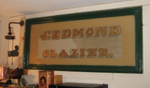 Edmond Glazier sign stripped repainted