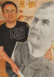 Holding cut out of William Watt August 2011